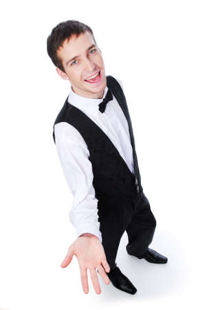 Young cheerful male waiter showing something - isolated on white