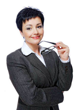 Mid adult businesswoman in grey business suit with glasses in hand photo