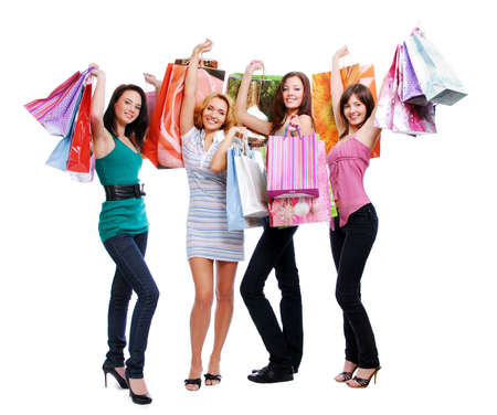fun beauty adult girls out shopping with colored bags, standing full. Isolated on white.