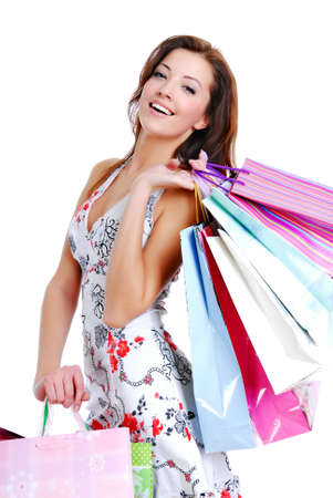 happy cute young woman shopping with color bags - isolated on white photo