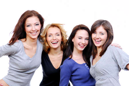 stylish women: Group of four sexy, beautiful young happy women. Isolated on white
