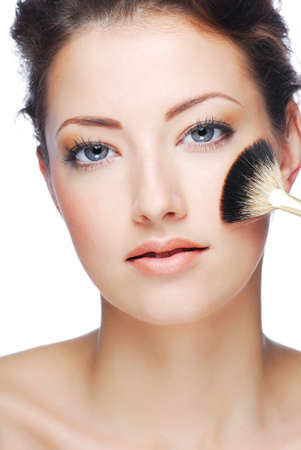 beautify: Portrait of attractive young adult woman cleaning face after applying make-up