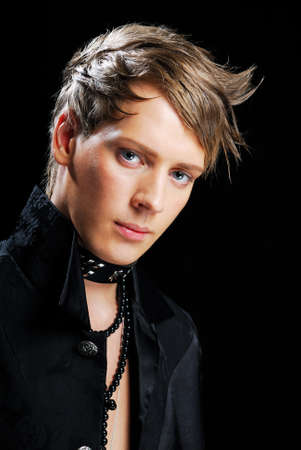 Attractive young man with creativity hairstyles on a blackbackground Stock Photo - 4293201