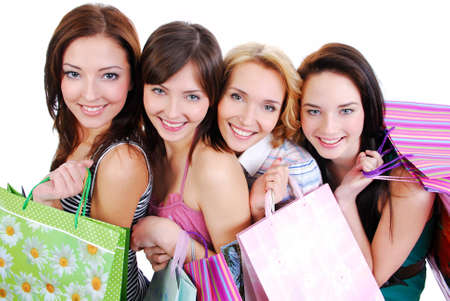 ange: Group of happy cute smiling adult girls with shopping bags, high ange view. Stock Photo