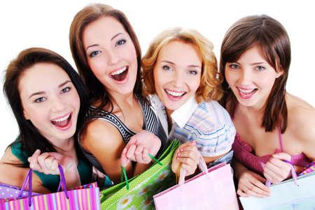Group of happy pretty laughing girls with shopping bags, high ange view.