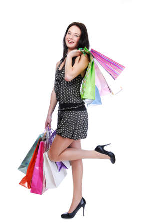 whitw: Laughing young woman standing isolated on white with color bags Stock Photo