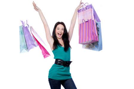 Cheerful young adult girl throw colored bags - white background áðîñàòü Stock Photo - 4297665