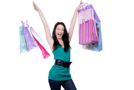 Cheerful young adult girl throw colored bags - white background �������   Stock Photo - 4297665