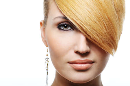 Front view portrait of beautiful blond woman with creativity hairstyle