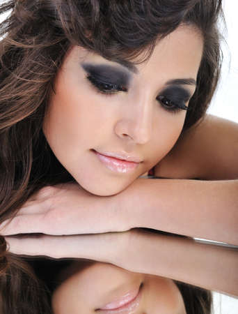 Face of pretty woman dreaming looking in mirror Stock Photo - 4321411