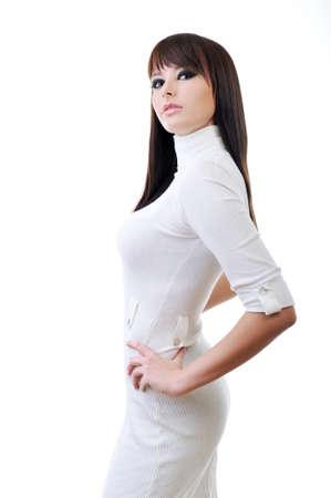 Beautiful woman in white elegant dress posing in studio photo