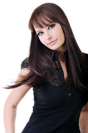 Beautiful young adult girl in black elegant dress posing in studio Stock Photo