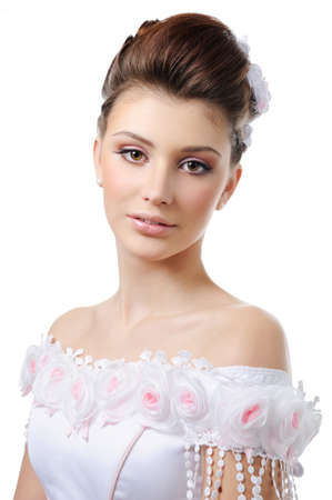 Portrait of young beauty bride with style hairstyle and make-up photo