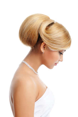 Elegance blond female  with creative hairstyle - profile view photo