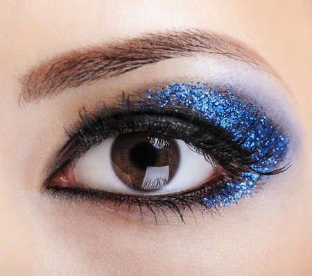 macro shot of woman eye with bright blue bright make-up -  Stock Photo - 4411056