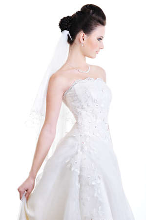 Profile view of elegant beautiful bride in beauty white dress