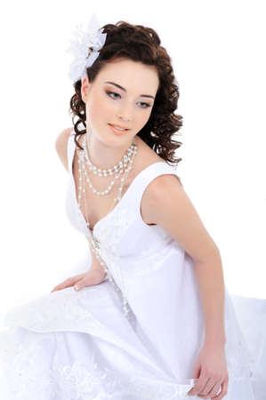 feminity: Young beautiful elegant bride - white background
