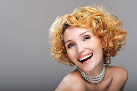 Portrait of beautiful laughing woman - blond curly hairstyle Stock Photo - 4521965