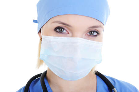 female surgeon: Close-up face of female surgeon in medical mask - isolated on white