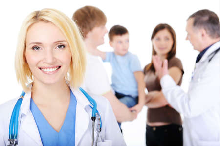 family doctor: portrait of happy successful young female doctor with the young family
