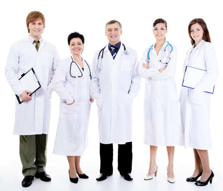 five happy successful smiling doctors standing together in row photo