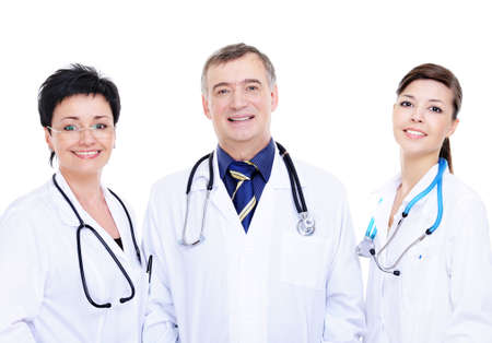 front view of three happy medical doctors standing together photo
