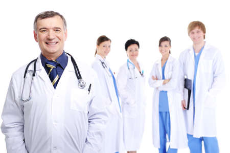 laughing successful mature male doctor with his colleagues  photo