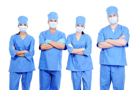 team of  four surgeons in blue uniform standing together  photo