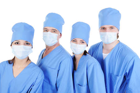 surgeons in medical blue uniform standing in line - isolated on white background  photo