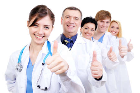hospital gown: group of happy laughing doctors with gesture thumbs-up standing in line