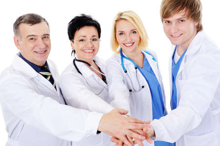 unity of four happy successful doctors - isolated on white background  photo