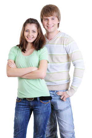 young happy  couple standing together - isolated on white background photo