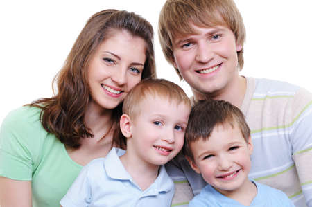 attractive portrait of young happy family with two sons - white background Stock Photo - 4565671