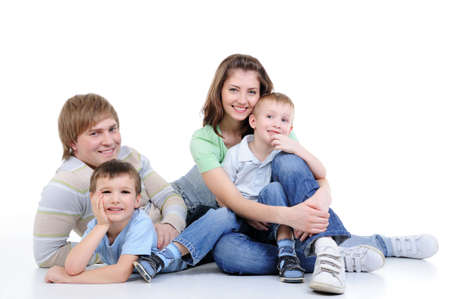 happy young family of four family enjoing together - isolated