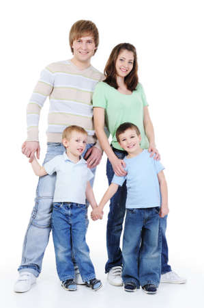 attractive full-length portrait of young happy family with two sons photo