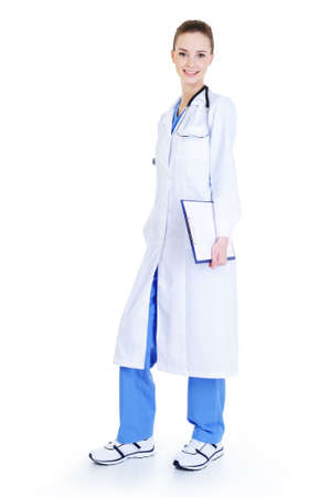 young beautiful nurse standing full-length - isolated on white background photo