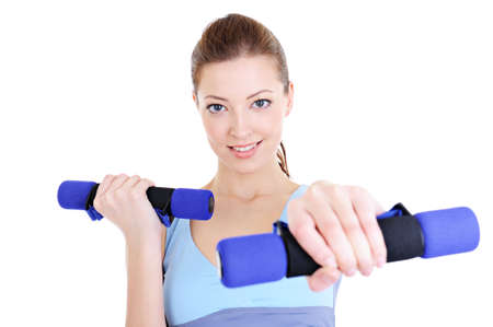 portrait of young beautiful woman doing physical exercises with dumbbells photo