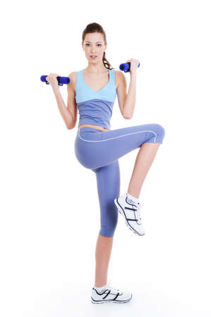 physical training exercise of young beautiful woman with dumbbells photo