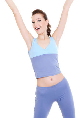 happy laughing attractive young woman doing physical exercises  photo