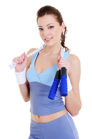 beautiful young woman training with jump rope - isolated photo