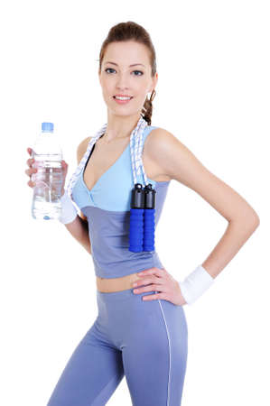 sporting beautiful woman with bottle of water in the hand  photo