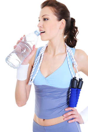 girl drinking water: young woman at the training recreation drinking water Stock Photo