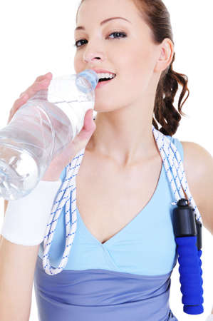 portrait of young attractive girl drinking water after train photo