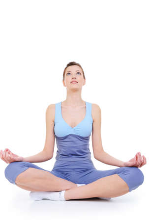 meditation as a recreation after train of young woman - isolated on white background photo