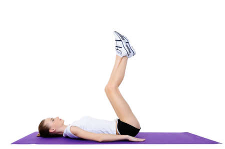 young adult girl doing physical exercises on the floor photo