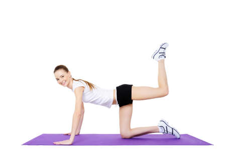 young female fitness and physical exercises - white background photo