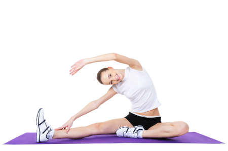 beautiful woman doing aerobic exercises - isolated on white photo