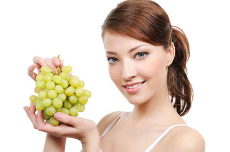 close-up portrait of young attractive woman with bunch of grapes  Stock Photo - 4632086