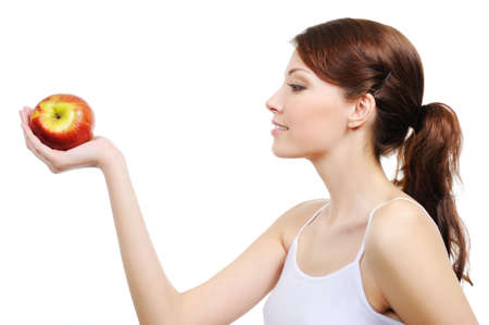 preference: beautiful woman with apple - isolated on white background Stock Photo