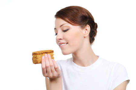 tempting: portrait of young woman eating tempting cake - isolated on white  Stock Photo
